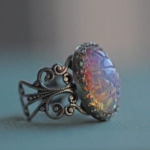 Harlequin Opal Engagement Ring. I love opals (my birthstone) and exotic pieces.