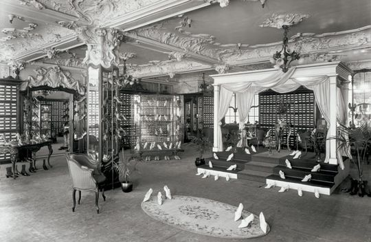 Early image of shoe display in Harrods department store