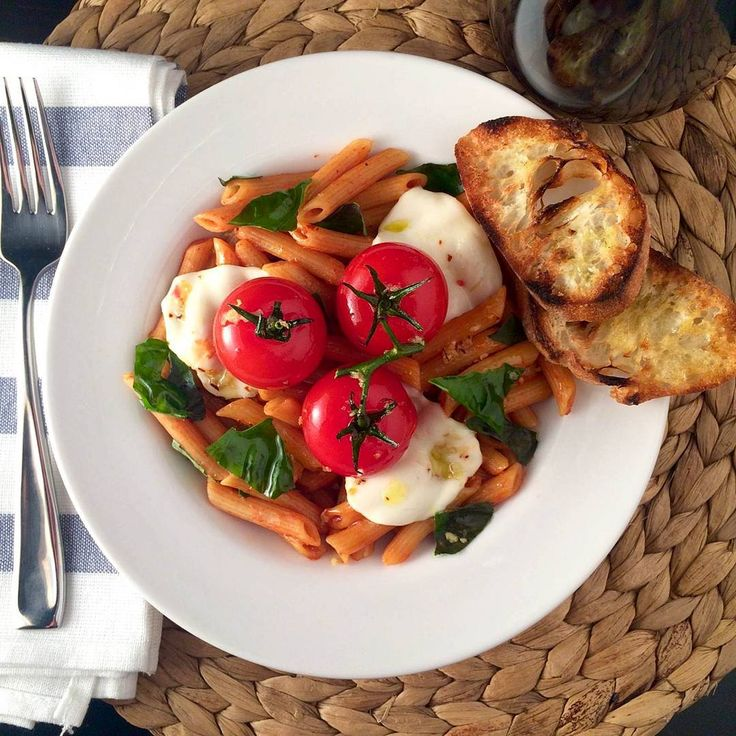 #MeatlessMonday Magic!  The penne mezzi was cooked in strained tomatoes, basil, garlic, shallots, spices and red pepper flakes. The tomatoes were roasted in olive oil, garlic and red pepper flakes. The two were brought together with fresh mozzarella and basil.  Hope your week is off to a fabulous start! @zimmysnook