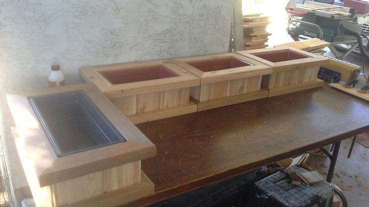 Cedar planters with removable plastic liners.