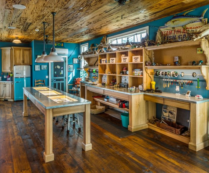 This unique space combines a homeowner's love for fishing and her desire for luxury living. The Tackle Shack was designed as a fully functional space to prepare freshly caught fish and display the homeowner's collections of rods and antique fishing lures.