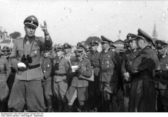 SS-Gruppenführer und Generalleutnant der Waffen-SS Wilhelm Bittrich speaking to officers in France in August 1943