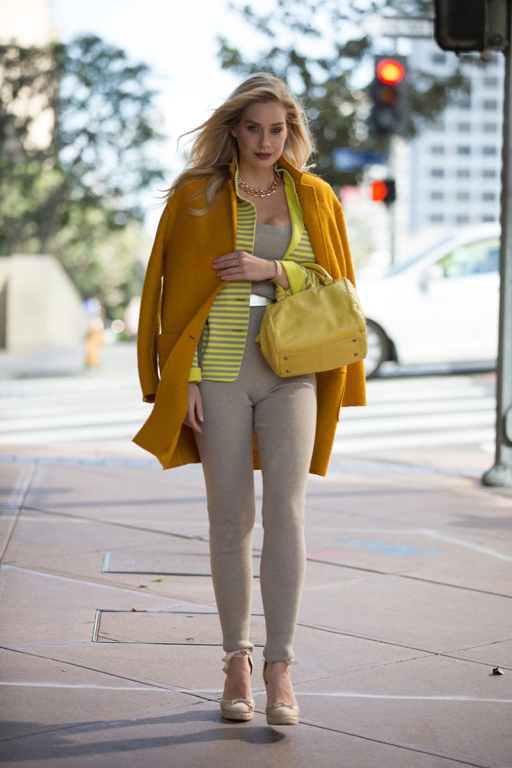 """Actress & fashion blogger Lily Levy carrying """"the absolute perfect sunny companion"""" to her beige and yellow outfit."""