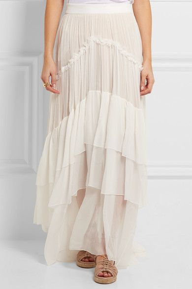 Chloé's boho-inspired maxi skirt perfectly captures the label's effortlessly feminine, free-spirited aesthetic. Cut from weightless silk-mousseline, the flowing silhouette is accentuated by ruffled trims and three floaty tiers. The featherweight fabric is underpinned with a discreet beige slip.