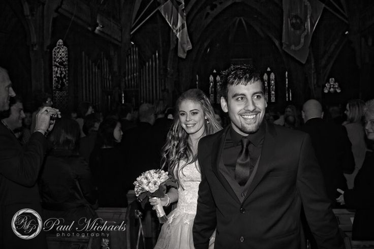 Walking out of St Pauls Church. PaulMichaels Wellington wedding photography http://www.paulmichaels.co.nz/