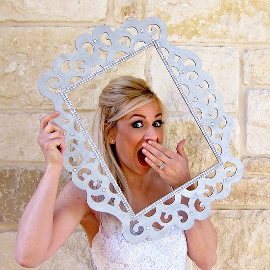 DIY Wedding Photo Booth Props: Frames | Morena.. hanging from a tree