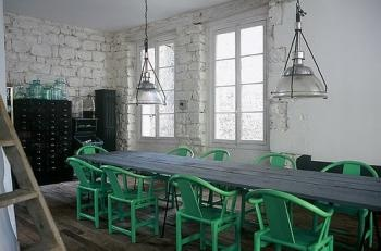 painted chairs: Dining Rooms, Elle Decor, Color, Stones Wall, Black Cabinets, Ferrari, Green Chairs, Long Tables, Black Wall