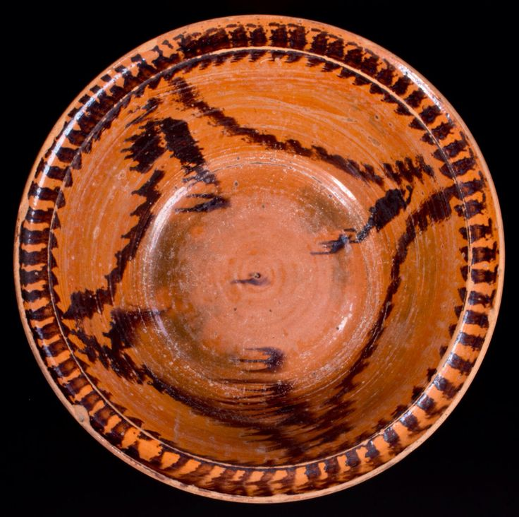 """Crocker Farm 3/19/16 Lot # 420.  Realized: $489 ($425 hammer, plus 15% buyer's premium).  Manganese-Decorated Redware Bowl, Pennsylvania origin, circa 1840-1875, tapered bowl with semi-rounded rim, decorated on the interior with a stylized sponged drape design and around the rim with additional manganese sponging. Wear to interior. Shallow chips to edge. A few shallow base chips. Diameter 12 1/8"""" ; H 3 3/4""""."""