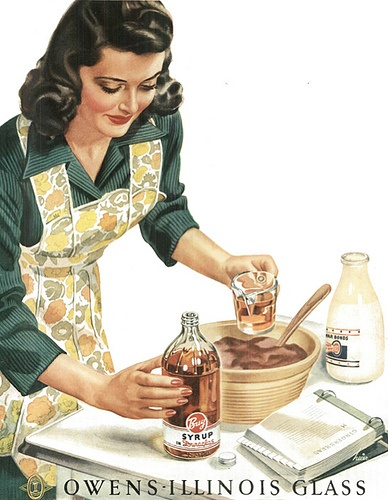 Vintage ad showing the homemaker with the requisite apron.  I guess aprons went out of fashion because our clothes aren't nice enough to want to protect!