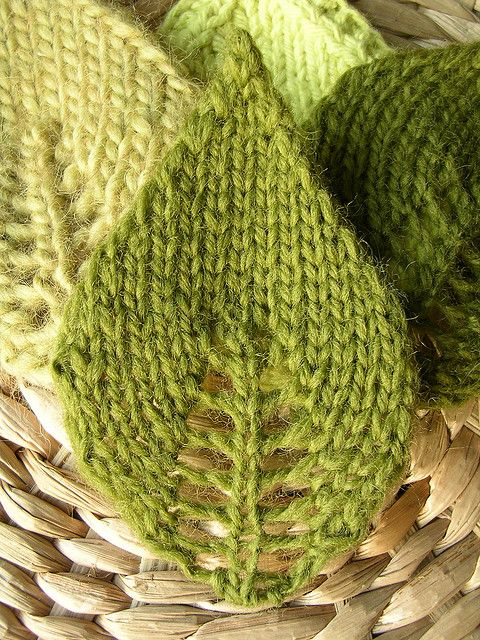 Knit Leaves (from Ravelry):   The pattern: CO 3 stitches & purl one row.  Leaf bottom: Working stockinette st, on all knit rows: knit to center st, yo, knit 1, yo, knit to end. Purl backside. Do this until leaf is as wide as you would like it (about 7 increase rows).  Leaf tip: Continuing in st st, on next knit rows: ssk, knit to last 2 sts, k2tog. Purl backside. When 3 sts remain, slip first 2 sts knitwise - knit 1 - pass 2 slipped stitches over the knit one.  Note: an alternate decrease…