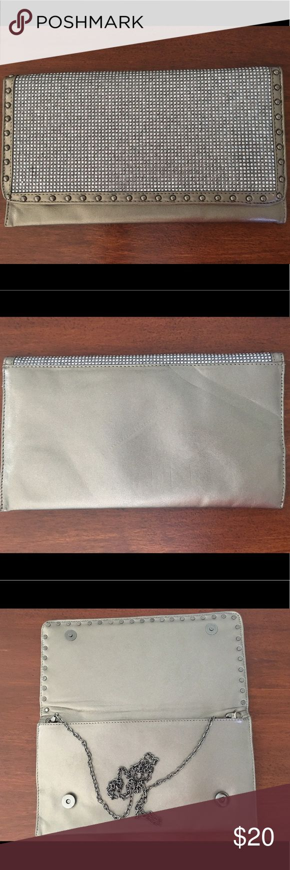 Sparkly clutch with chain strap. Sparkling silver clutch with metal chain strap. Magnetic closure. mms Bags Clutches & Wristlets