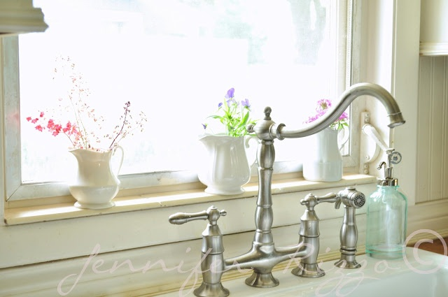Love the row of creamers holding flowers in a kitchen window - Jennifer Rizzo: Summer tour of homes day 4....