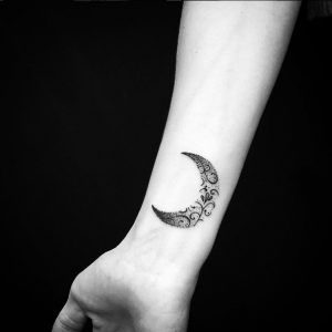 Dotwork crescent moon wrist tattoo by Alex Treze