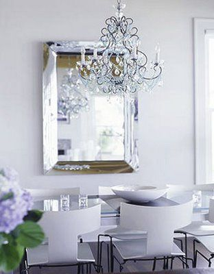 Love This Eclectic Dining Room Beveled Silver Mirror, Crystal Glass  Chandelier, Glass Top Modern Dining Table, Modern White Plastic Dining  Chairs And ...