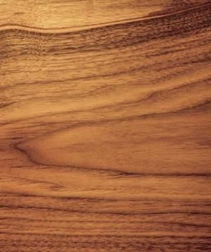 Walnut is a straight-grained hardwood that ranges from chocolate brown (when it's from the center of the tree) to yellow (from the outer portion of the tree). A top pick for head-boards, ornate antique-style dining tables, and mantels, walnut is typically clear-coated or oiled to bring out its color.