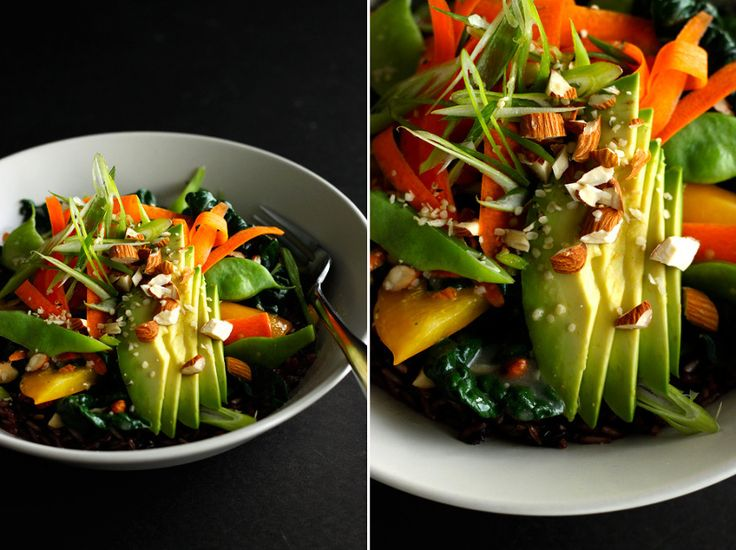 warm rice bowl topped with vegetables, avocado, toasted nuts and vegan ginger miso gravy