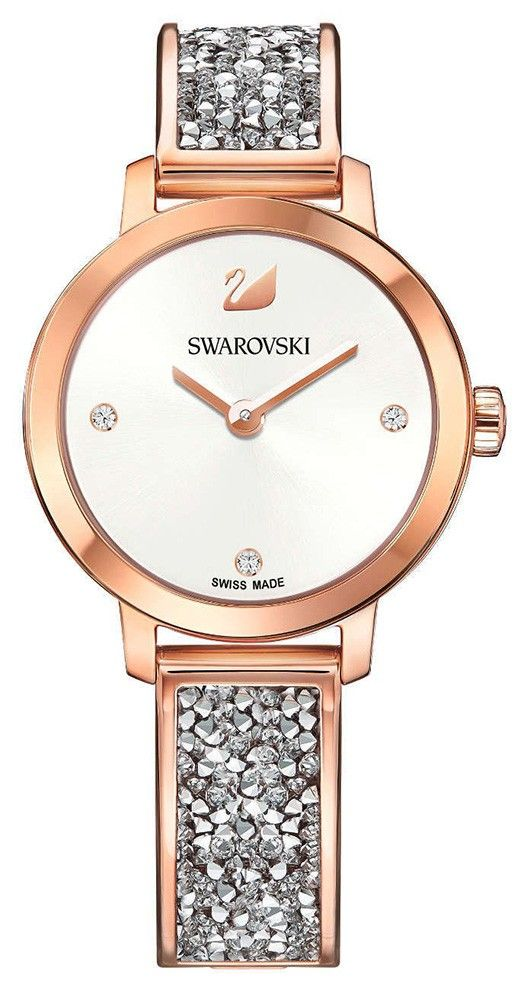 Swarovski Dameshorloge Cosmic Rock rosékleurig 5376092. Trendy en sprankelend dameshorloge uit de Swarovski Crystal Collectie. Het horloge heeft een ronde rosékleurige kast en een horlogeband met grijze rystalrock kristallen. De witte wijzerplaat met een doorsnee van 29 mm is voorzien van kristallen als index en uiteraard ontbreekt het bekende Swarovski zwaantje niet. De band sluit door middel van een klepsluiting. Het model is 50 meter waterdicht en heeft een Zwitsers uurwerk.
