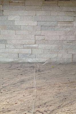 white river granite and ledgestone backsplash