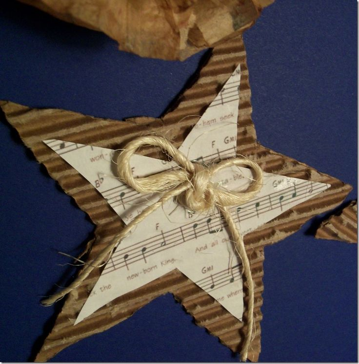 create Christmas carol ornament or gift tag---cut holiday shape from corrugated cardboard, print holiday music to cut into same shape, glue and attach raffia bow!