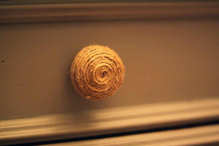 Twine covered knob creates a shabby chic or nautical feel and could be a no cost update to a dresser or cabinet.