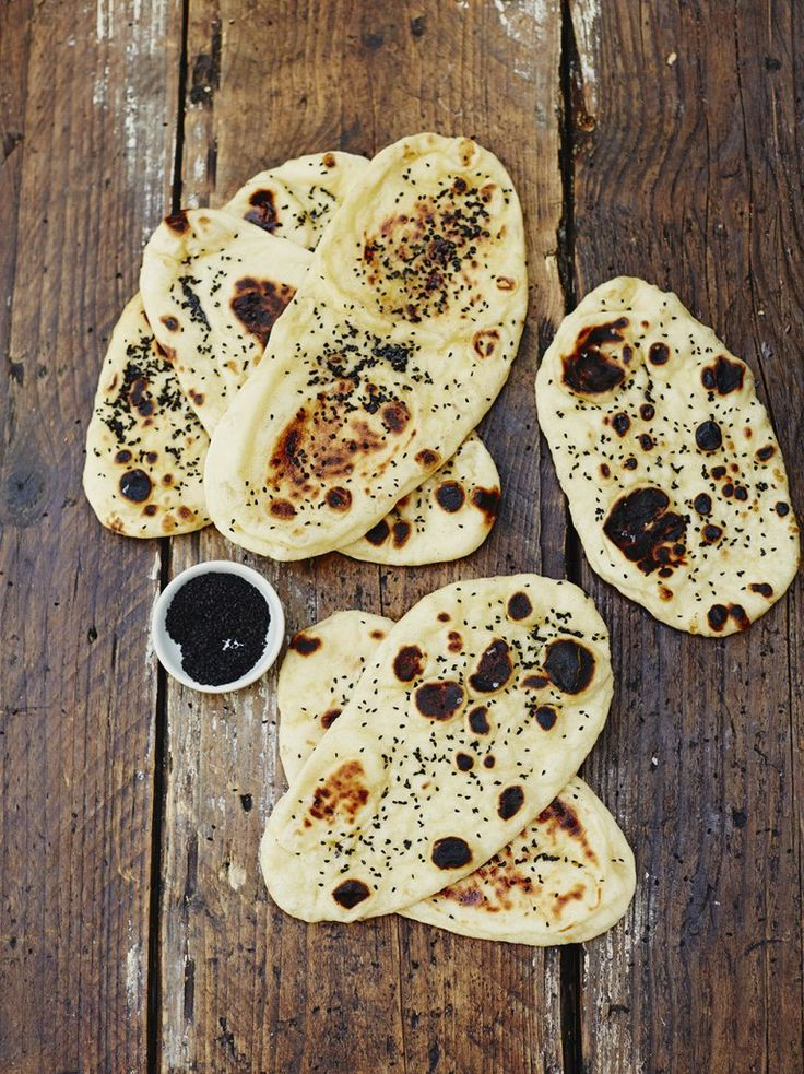 Naan Bread ½ x 7	g sachet of	dried yeast 1	teaspoon	runny honey 45	g	ghee	, or unsalted butter 250	g	strong white bread flour	, plus extra for dusting sea salt 3	heaped tablespoons	low-fat natural yoghurt 1	tablespoon	nigella seeds