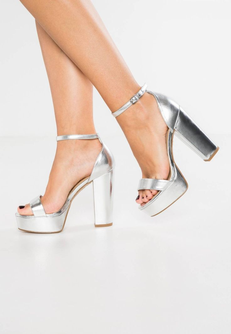 "New Look Wide Fit. TESSY 2 - High heeled sandals - silver. Pattern:plain. heel height:4.5 "" (Size 4). Platform height:1.5 "" (Size 4). Heel type:block heel,platform toe. shoe width:large. Insole:imitation leather. Sole:synthetics. Padding type:Cold padding...."