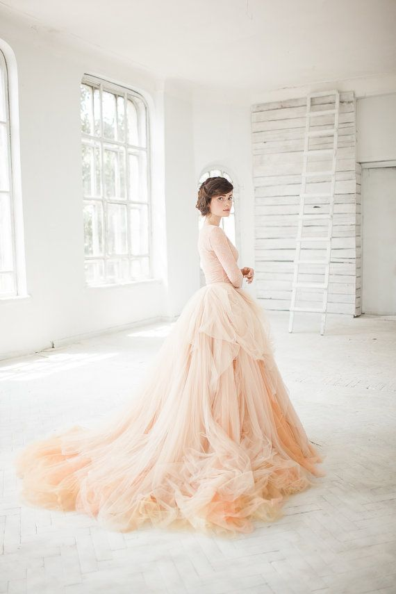 This listing is for nude tulle skirt and ivory tulle underskirt wich make this it puffy and volumetric.  The main skirt consists of many layers