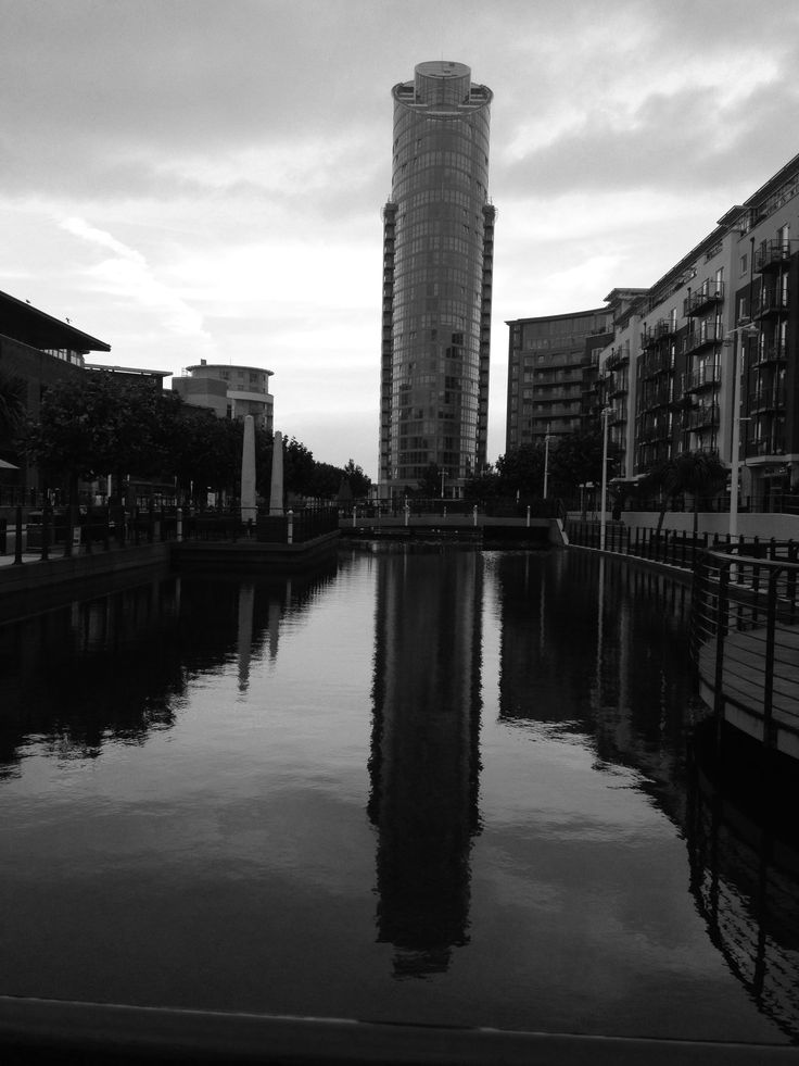 in this photo i made this black and white because it show the reflection on the water and the buildings around it