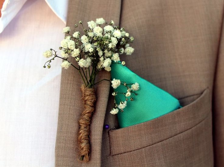 Wraps aren't only good for bouquets, as you can wrap your boutonnieres as well! If you are having a rustic wedding, consider burlap or twine for the perfect touch.  http://www.rosepetalevent.com/  #boutonniere #rosepetalevents #weddingflower #wedding  Photo Source: https://pixabay.com/en/arrangement-flowers-groom-lapel-1375783/