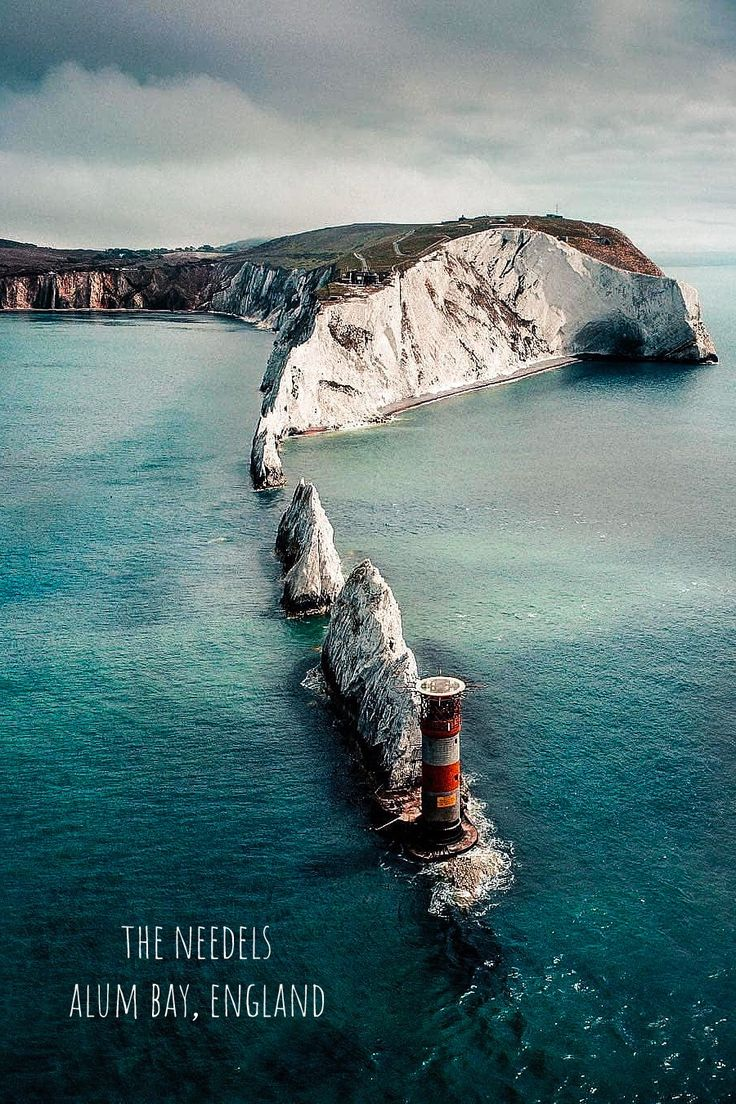 The Needes in Alum Bay, England. The Needles is a row of three distinctive stack…
