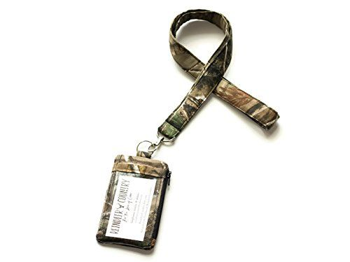Camo id holder with Lanyard - Realtree Camouflage id badge wallet and lanyard. This great id holder and lanyard set includes a fully lined zip pouch with clear slip pocket on the outside to hold an id or badge, and a lanyard that attaches to the id holder with a lobster clasp. Both the id holder and lanyard are made with Realtree camo fabric. Inside of zip pouch is lined with black cotton fabric.The lanyard is designed and made to lay flat on the chest while wearing and is lightly padded…