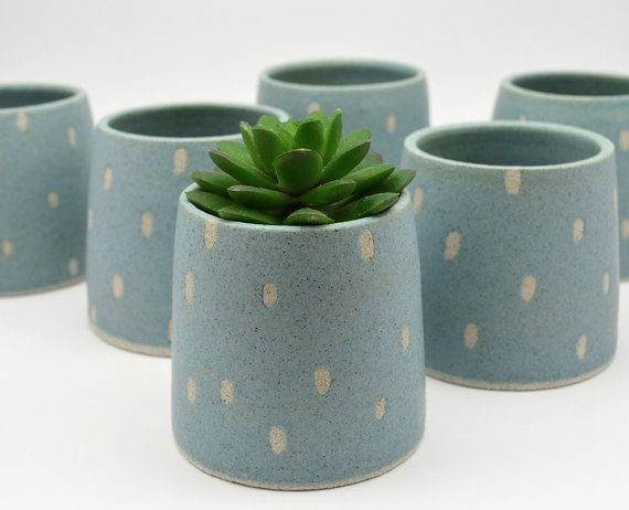 This stoneware planter/pot has been hand made by me from earthy textured clay on the wheel. It has been decorated and patterned with a matt teal