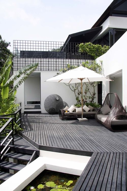 outdoor area | contemporary outdoor furniture + black wood plank floors