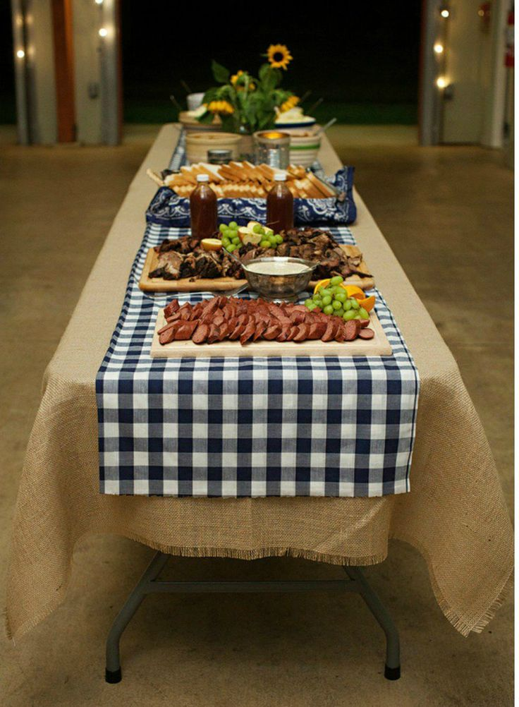 Navy gingham table runner over burlap tablecloth.