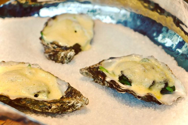 These poached fresh oysters with a spinach and Hollandaise sauce garnish should be on your bucket list!