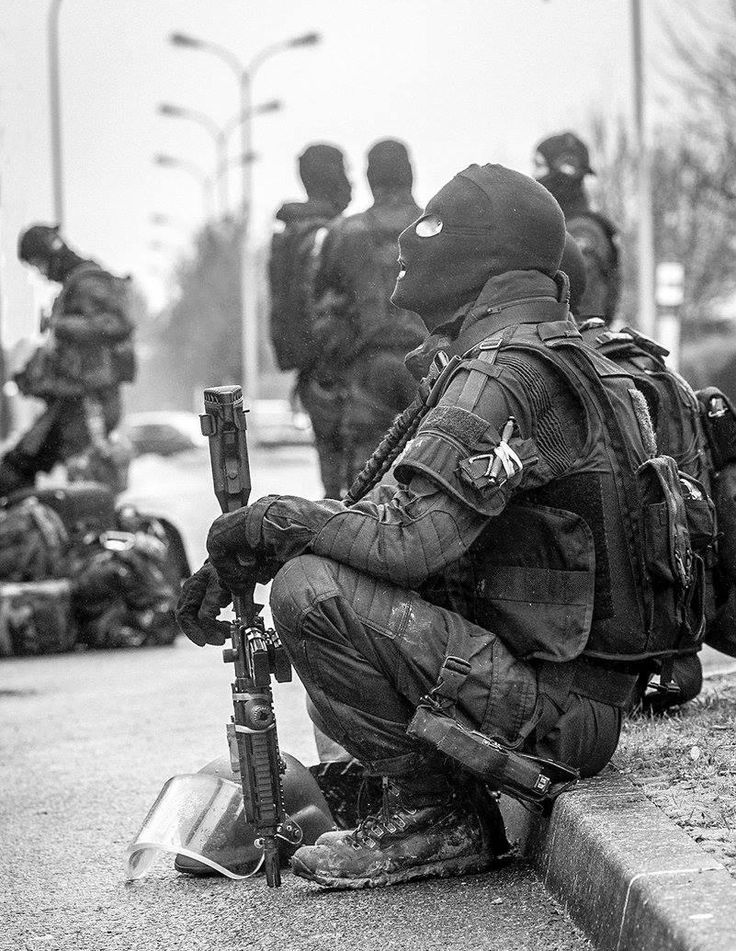 """Operator of french GIGN (Counter-terrorism unit of """"Gendarmerie nationale"""" - Military police) during a rural intervention."""