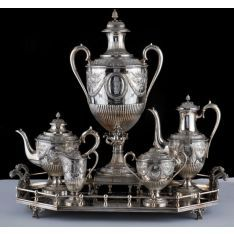 A late Victorian silver plate tea and coffee service, makers mark Boardman, Glossop & Co, Sheffield & London circa 1880, the comprising a tea urn, teapot, coffee pot, sugar bowl and milk jug each of ovoid footed form, lidded with pineapple finial.   The Glossop Family of Silversmiths were of French Huguenot descent