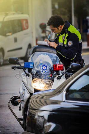 Traffic policeman on the street in Izmir (Turkey) – Stock Editorial Photo © carlotoffolo #147780687