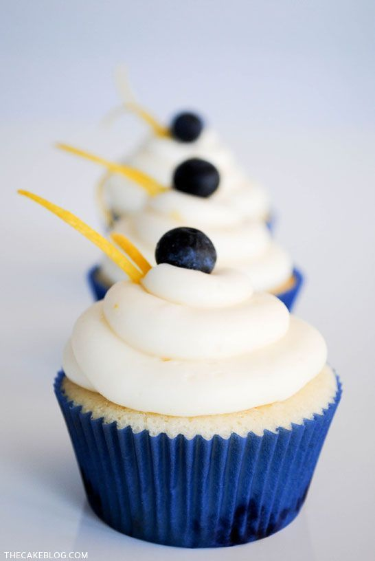 A fresh cupcake recipe for summer. Fresh blueberry cupcakes topped with lemon cream cheese frosting. Garnished with lemon zest and more blueberries. Perfectly tangy and sweet.