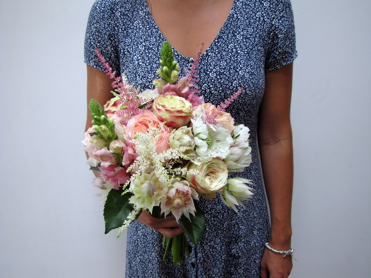 Bridal bouquet with Scabiosa, Astilbe, Roses, Serruria and Antirrhinum
