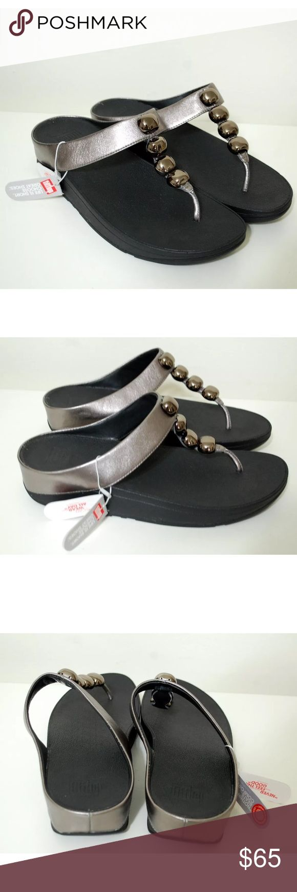 Fitflop rola Pewter Sandals Fitflop Rola Sandals  Color- Pewter Size-11  Has some writing on bottoms otherwise new with tags. Fitflop Shoes Sandals