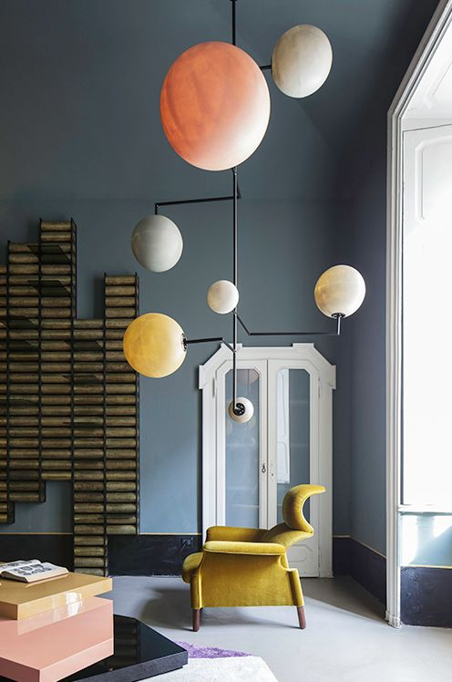 Great hanging light, like a giant mobile of planets! #interior #design #home