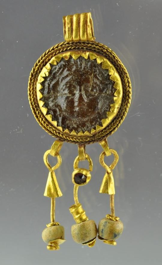 Roman jewelry, Roman gold pendant with glass token, 2nd centyry A.D. Roman jewelry, Roman gold jewelry, Roman gold pendant with inserted glass token with Gorgon head, gold pendant with 3 gold chains with glass decorations, 1.9 cm diameter 4.8 cm long. Private collection