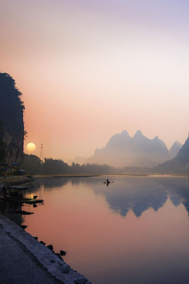 Morning Fishing at Li River in Guangxi Zhuang, China