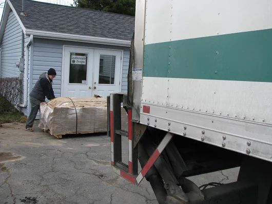Truck with tailgate lowered pallet load of leather in front of our leather shop: http://www.leathersmithdesigns.com/ #LeatherShop #Leather