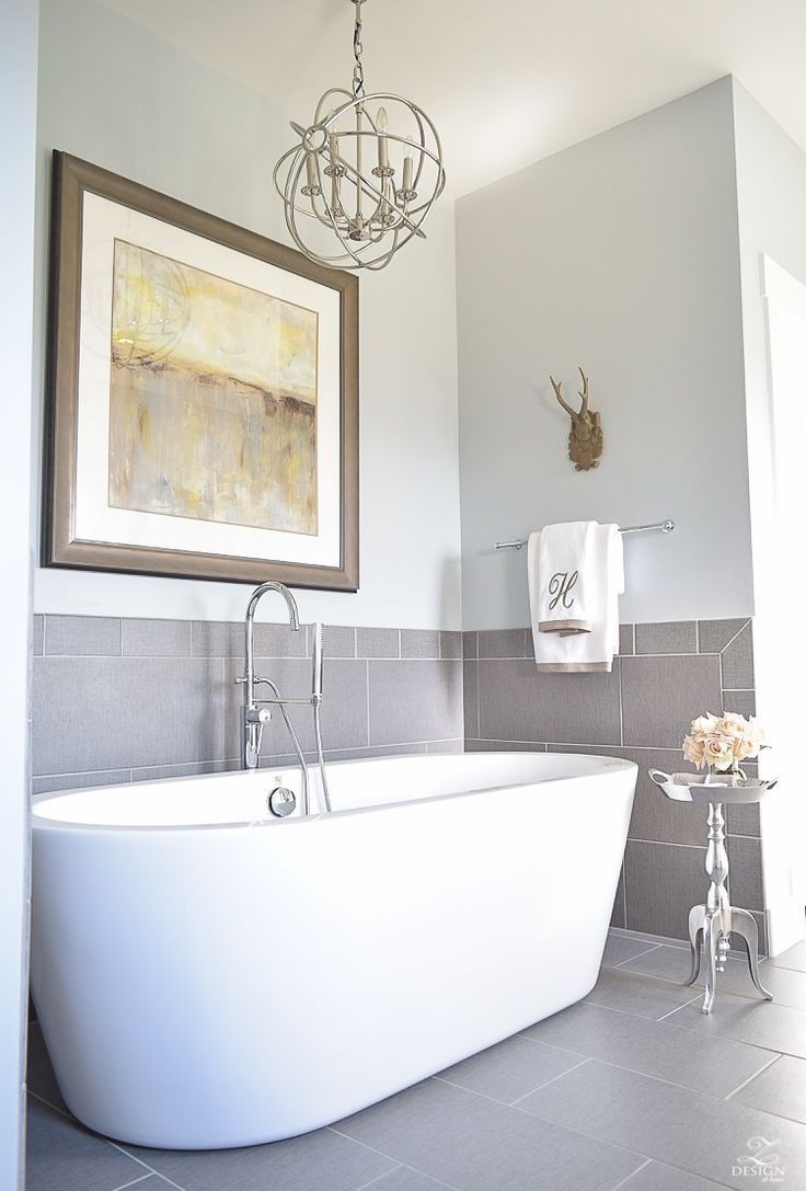 We love the art and frame combo for this bathroom space! While most of the elements of this bathroom space are done in cool tones, the warmer grey colors of the custom framed art allow it to really shine and be the star here. Fantastic!