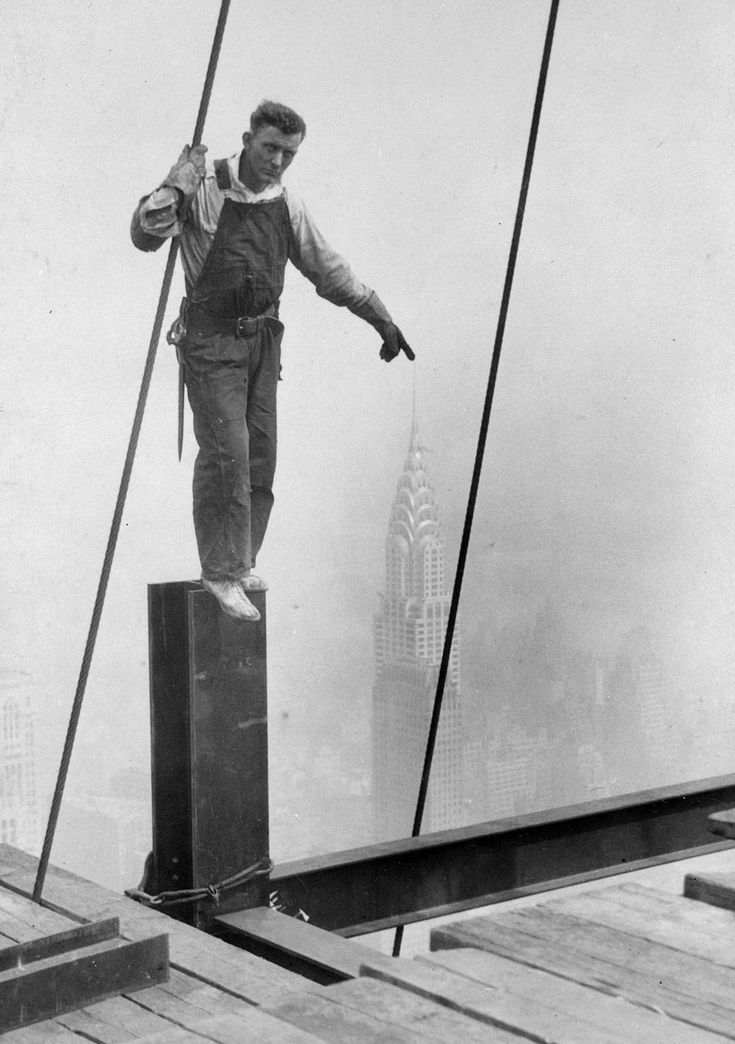 Love this photo: Lewis Hine, Empire State Building Construction Worker Touching The Top Of The Chrysler Building, 1930 ©