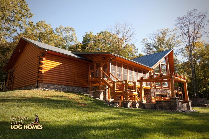 Log home by golden eagle log homes prow feature wall for Log cabin with basement