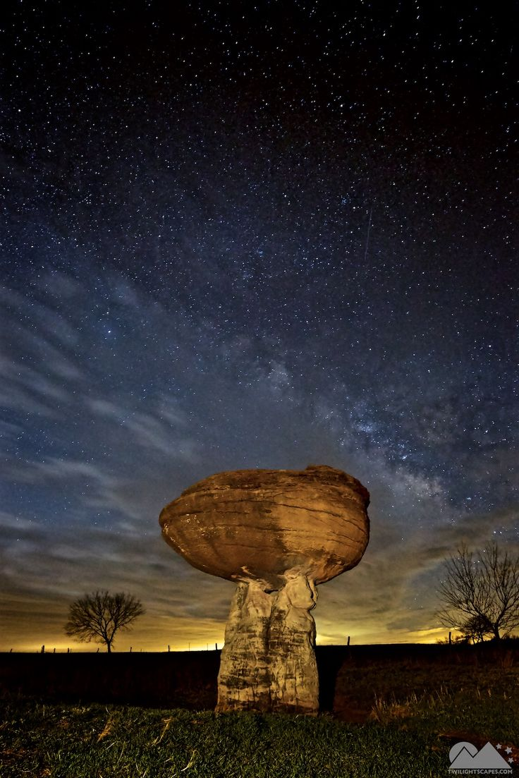 """Night 263 A wonderful formation dubbed """"mushroom rock"""" in the middle of nowhere, Kansas. Yes, I typed that correctly, Kansas. Here I used the light pollution on the horizon to play with the contrasting milky way above it and then I got lucky with some clouds that rolled in quickly to help complete the...  View More: http://yearofnight.com/night-263/ Tags:  #BlueHour, #Clouds, #Grass, #Green, #Kansas, #LightPainting, #MilkyWay, #Rocks, #Stone, #Twilightscapes, #Yearofn"""