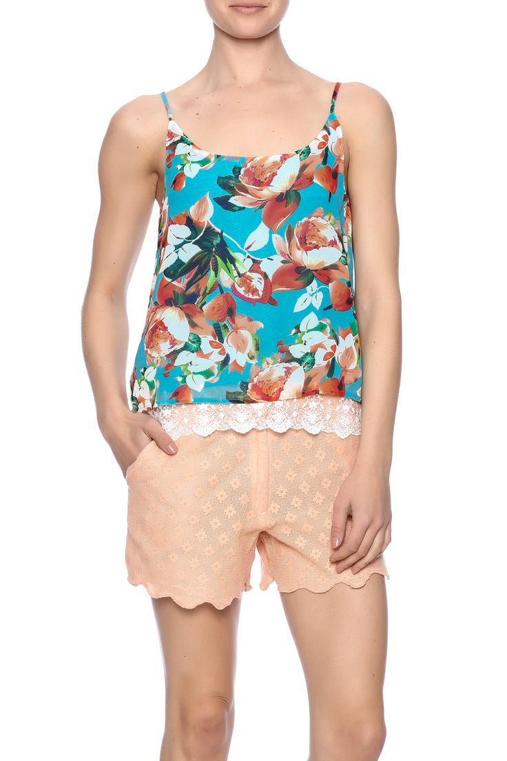 Swing tank with spaghetti straps and scoop back. Fully lined. A separate solid lining has a pretty lace hemline that shows from underneath.  Turquoise Tropical Lace Tank by Twist. Clothing - Tops - Sleeveless Clothing - Tops - Blouses & Shirts Santa Monica Los Angeles California